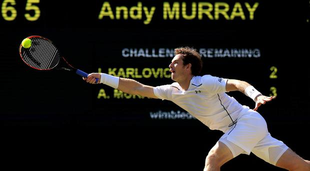 Andy Murray in action against Ivo Karlovic. Photo credit: Jonathan Brady/PA Wire