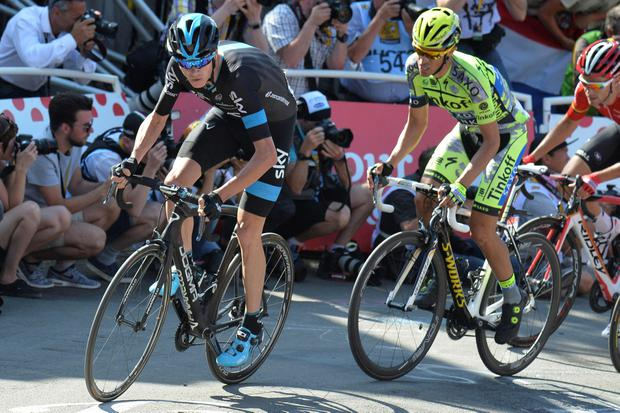 Britain's Christopher Froome, left, and Spain's Alberto Contador, right, climb Mur de Huy during the third stage of the Tour de France cycling race over 159.5 kilometers (99.1 miles) with start in Antwerp and finish in Huy, Belgium, Monday, July 6, 2015. (AP Photo/Bernard Papon, Pool)