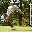 Eyes on ball: Rory McIlrory enjoys a kickabout during downtime as it helps him to take his mind away from golfing matters
