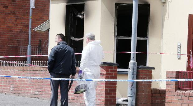 PSNI officers at the scene on Agincourt Avenue in south Belfast after a fire broke out on a ground floor apartment. Picture by Jonathan Porter/Press Eye