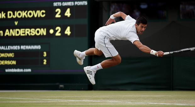 Serbia's Novak Djokovic returns against South Africa's Kevin Anderson during their men's singles fourth round match on day eight of the 2015 Wimbledon Championships at The All England Tennis Club in Wimbledon, southwest London, on July 7, 2015. Djokovic won 6-7, 6-7, 6-1, 6-4, 7-5. RESTRICTED TO EDITORIAL USE -- AFP PHOTO / ADRIAN DENNISADRIAN DENNIS/AFP/Getty Images
