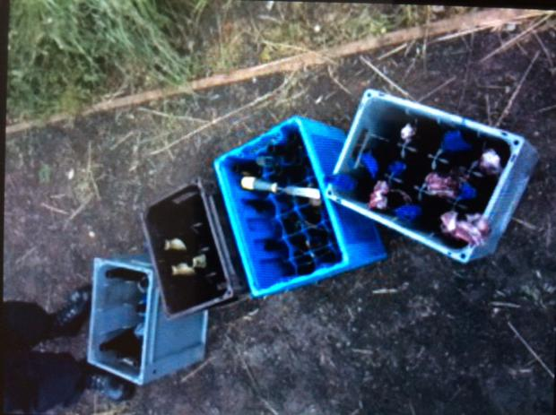 The crates of petrol bombs seized in a west Belfast alleyway