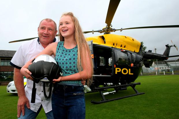 Alanna Casement, 12, from Annacloy, Co Down, with Raymond Rice, a friend's father who administered vital first aid at the scene