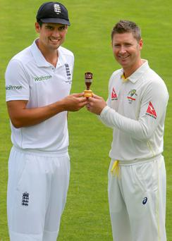 Hands-on: England skipper Alastair Cook (left) and Australia counterpart Michael Clarke will battle for the urn