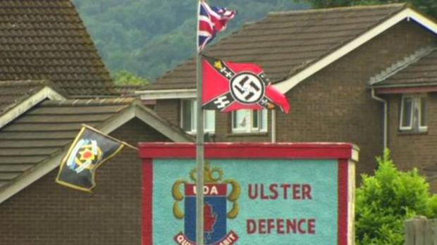 Nazi and paramilitary flags have appeared near a loyalist bonfire in Carrickfergus Picture: BBC