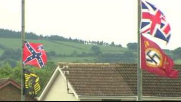 A confederate flag flown alongside a Nazi flag and Union flag in Carrickfergus Pic: BBC