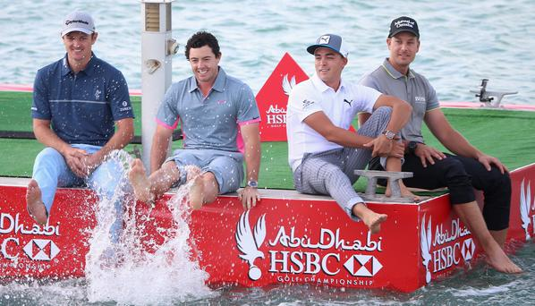 Splashing time: Justin Rose, Rory McIlroy and Rickie Fowler enjoy some down time, as Rose believes they should
