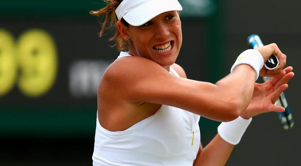Marching on: Garbine Muguruza is in her first Slam semi-final