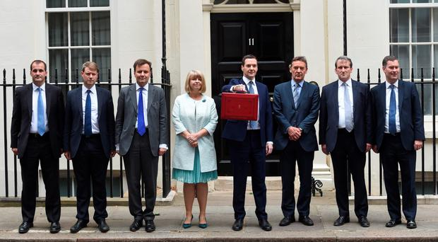 The Chancellor of the Exchequer George Osborne (4th R) and his treasury team