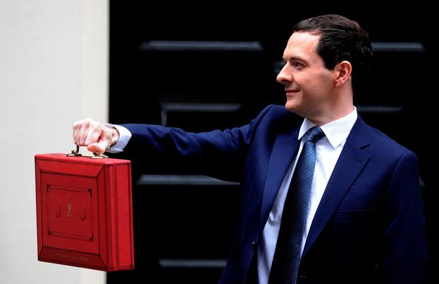 Chancellor of the Exchequer George Osborne holds his ministerial red box up to the media as he leaves 11 Downing Street on July 8, 2015 in London, England (Photo by Stuart C. Wilson/Getty Images)