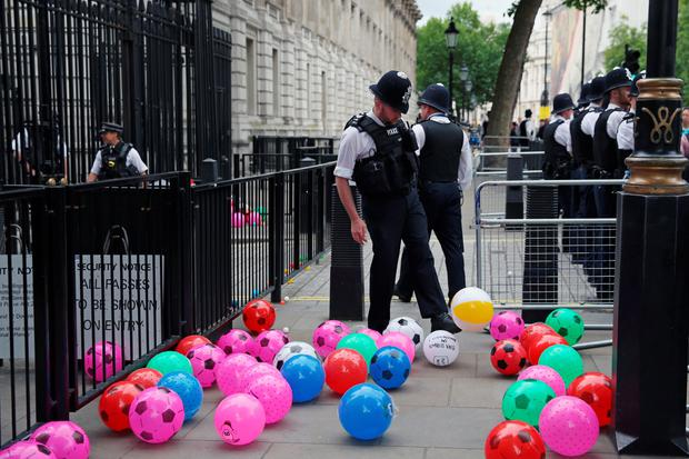 Anti austerity protesters throw balls towards Downing Street (Photo by Dan Kitwood/Getty Images)