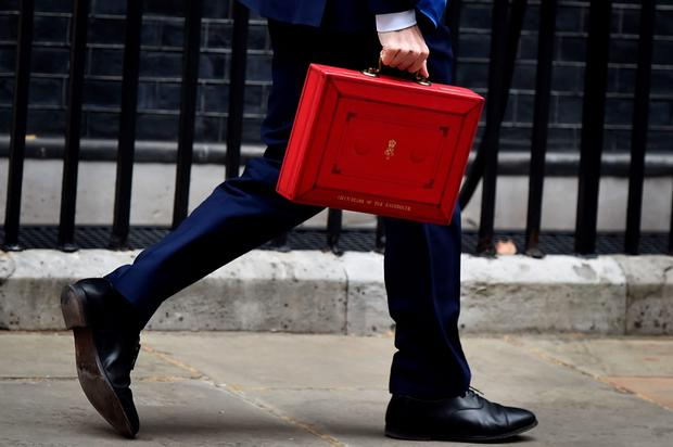 George Osborne carries the Budget Box as he walks down Downing Street. AFP/Getty Images