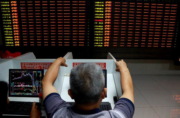An investor observes stock market at a stock exchange hall on July 8, 2015 in Fuyang, Anhui Province of China. (Photo by ChinaFotoPress/Getty Images)
