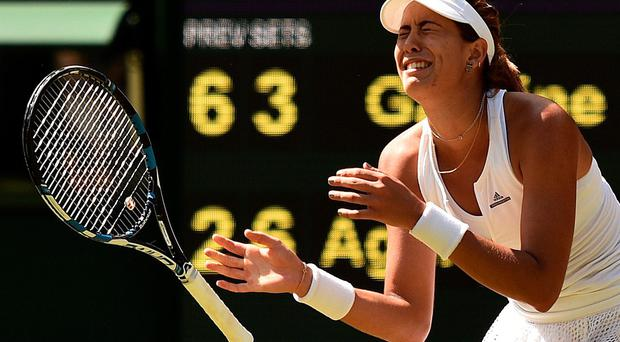 Emotional moment: Garbine Muguruza celebrates victory over Agnieszka Radwanska in the Wimbledon semi-final