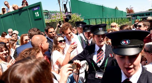 Fans' favourite: Andy Murray poses with supporters yesterday