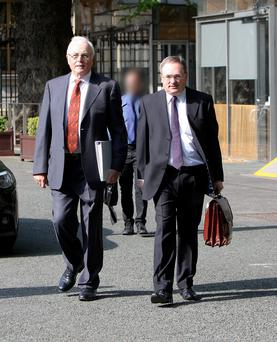 Nama chairman Frank Daly (left) and chief executive Brendan McDonagh arrive to give evidence at the Dail yesterday