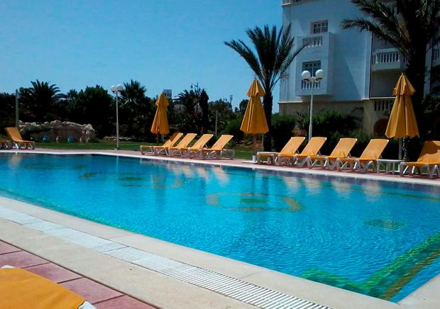 Empty deck chairs around a pool at Hotel Belisaire in Hammamet, Tunisia, as a British holidaymaker has said she is