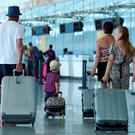 British tourists arrive at the Enfidha International airport in the Tunisian capital Tunis on July 10, 2015 after the British Foreign Office advised tourists to leave the North African country by saying it was unsafe for holidays.