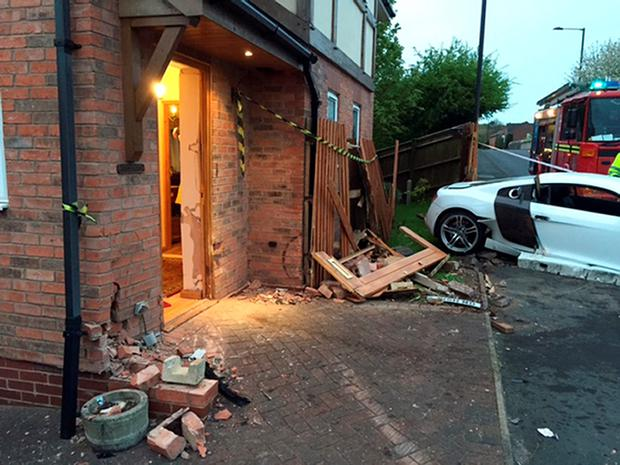 Damage caused to the home of Janet and Harold Perry in Suton Coldfield after Harry Bishop drove his father's Audi R8 into their home