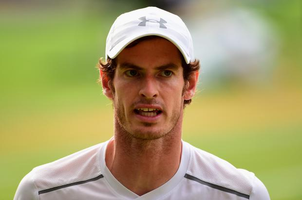 Andy Murray of Great Britain reacts during the Gentlemens Singles Semi Final match against Roger Federer of Switzerland (Photo by Shaun Botterill/Getty Images)