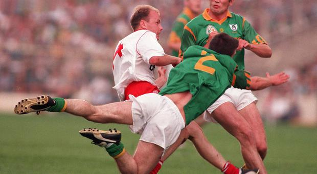 Crunch time: Peter Canavan feels the weight of Meath tackling in battle of '96