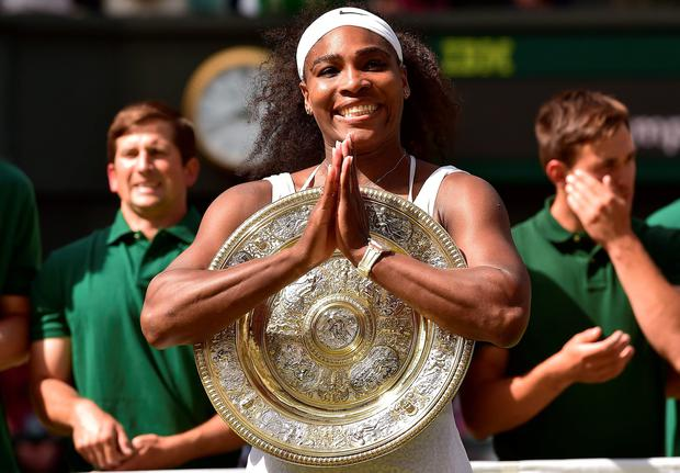 US player Serena Williams celebrates with the winner's trophy, the Venus Rosewater Dish, after her women's singles final victory over Spain's Garbine Muguruza. AFP/Getty Images