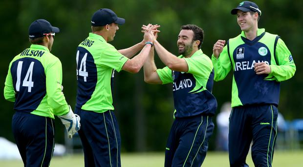 Here we go: Ireland's Craig Young (left) celebrates wicket against USA at Stormont with Stuart Thompson