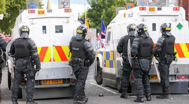 Pictured is police riot officers dealing with violence at the Orange order parade as it reaches its stopping point on the Woodvale road in North Belfast, Northern Ireland. Picture by Kevin Scott / Presseye.
