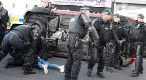 Flashback - July 13, 2015 - A young girl lies injured on the ground after a car drove into the crowd in front of the Ardoyne shops in north Belfast. PSNI officers had to tip the car to get to her.