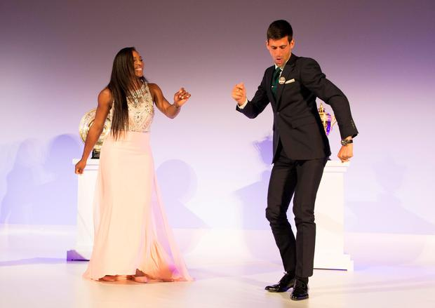Fine tuning: Novak Djokovic dances with Serena Williams at the Wimbledon champions' dinner and (inset) lifts the title