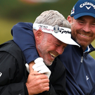 Thomas Bjorn of Denmark jokes with Darren Clarke of Northern Ireland during practice ahead of the 144th Open Championship at The Old Course on July 14, 2015 in St Andrews, Scotland. (Photo by Stuart Franklin/Getty Images)