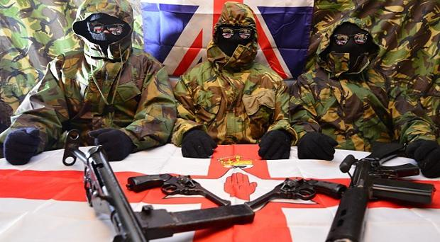 Three members of the unnamed loyalist group in Northern Ireland that has threatened police and parade officials