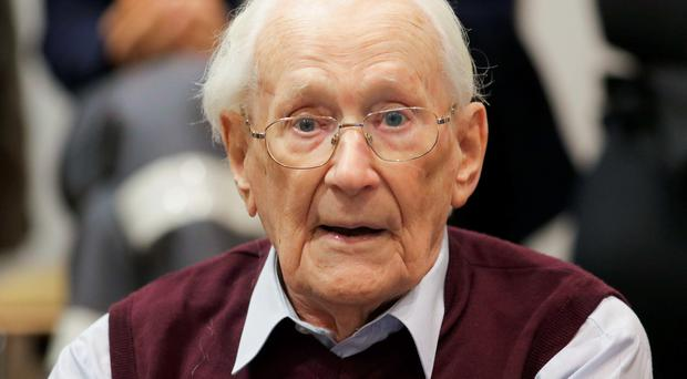 Former Nazi SS officer Oskar Groening listens to the verdict of his trial on July 15, 2015 at court in Lueneburg, northern Germany.