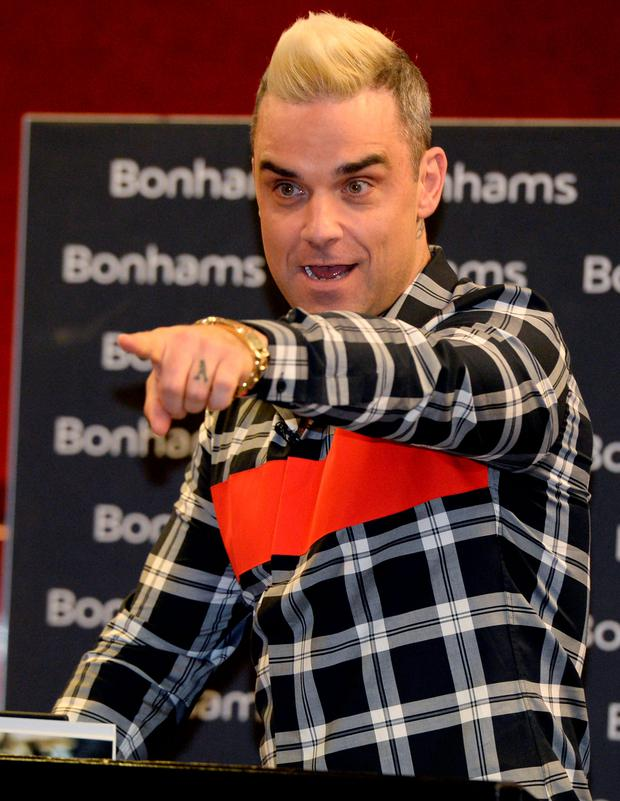 Robbie Williams showed you can sing when you're bidding as he made his debut as an auctioneer