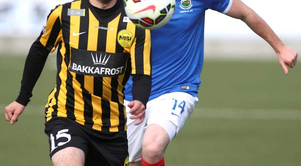 Euro charge: Linfield's Aaron Burns in action against NSI Runavik's Johan Jacobsen PRESSEYE