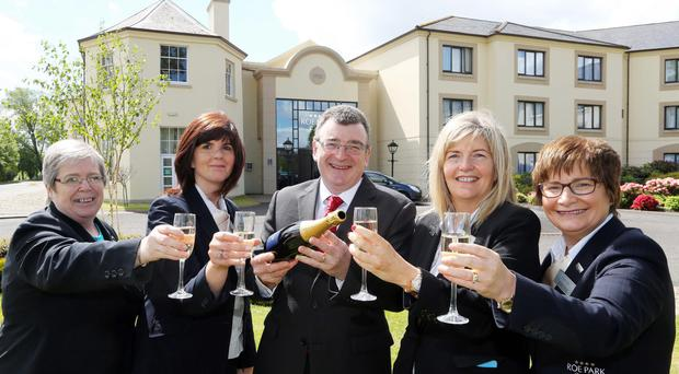 George Graham (centre), Roe Park Resort's general manager, with staff members celebrating the resort's 20th anniversary
