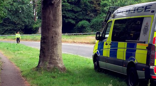 Police at a roadblock close to where a man was stabbed to death by another motorist in Findon, West Sussex.