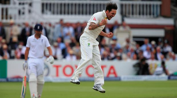 Australia bowler Mitchell Johnson celebrates taking the wicket of England batsman Joe Root during day two of the Second Investec Ashes Test at Lord's, London .Nick Potts/PA Wire.