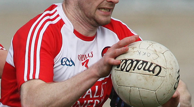 Power: Niall Holly's strength will be vital in Derry's midfield