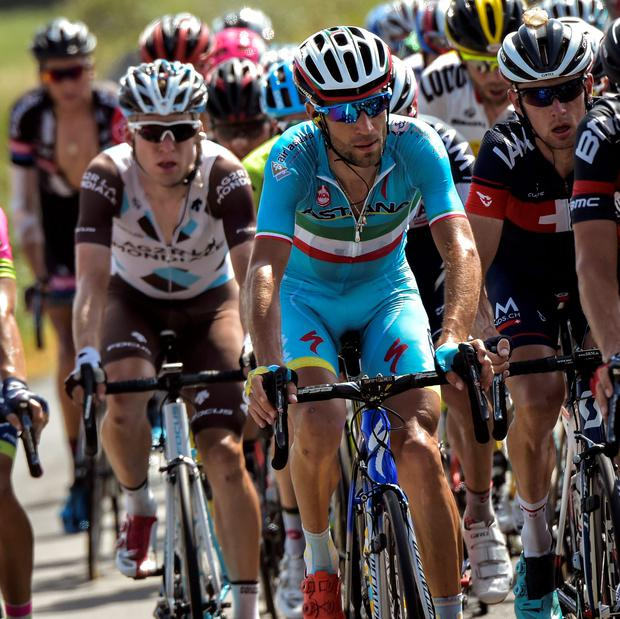 Up and down day: Vincenzo Nibali (c) suffered a puncture on yesterday's stage but soon caught up with the peloton
