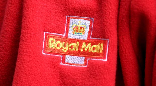Shares in Royal Mail fell sharply after its regulator confirmed the scope of a