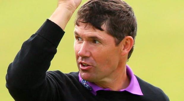 Hat's off: Padraig Harrington salutes the St Andrews crowd