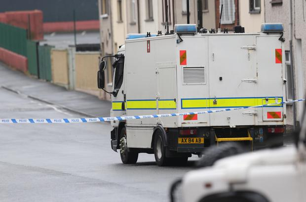 Army bomb disposal officers attend the scene on Victoria Street after a call to the Samaritans saying a bomb had failed to detonate.