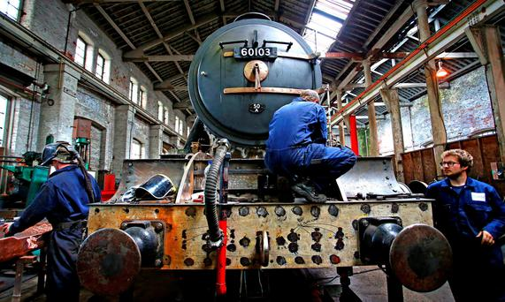 Co-Director Colin Green (centre) partakes in restoration work on the Flying Scotsman Steam is undertaken by Riley & Son Ltd in Bury, Greater Manchester. Peter Byrne/PA Wire.