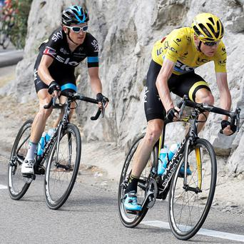 Chris Froome (right) has a lead of three minutes 10 seconds over his closest challenger