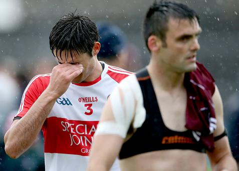 Pain of defeat: Derry's Christopher McKaigue and Eoin Bradley can't hide their disappointment after their defeat to Galway