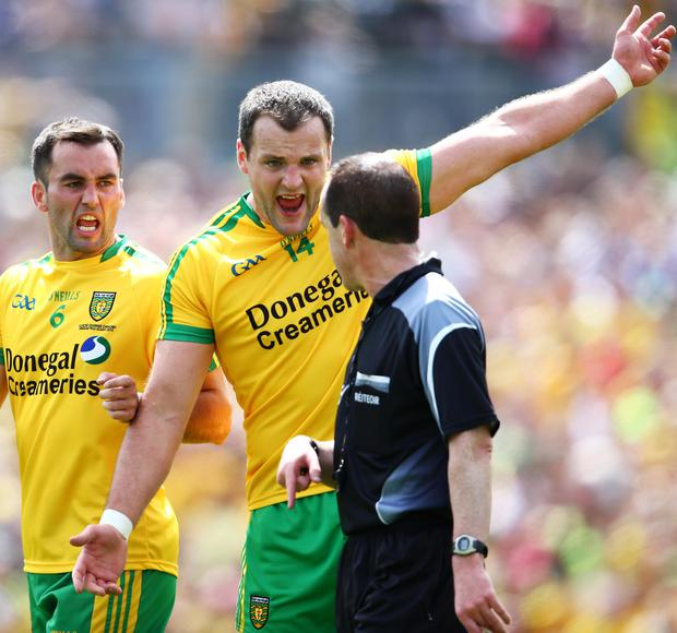 Pointing the way: Donegal's Karl Lacey and Michael Murphy argue with referee David Coldrick