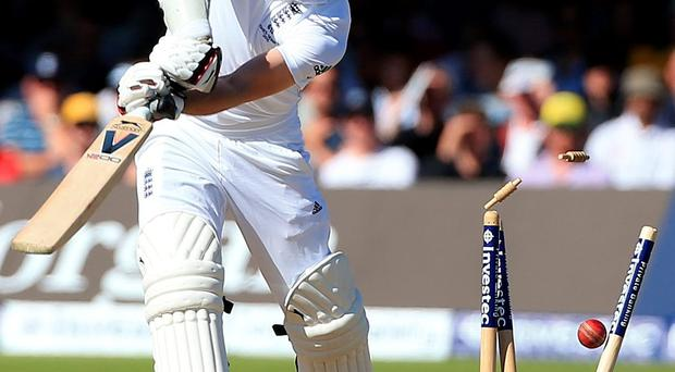 Bail out: Jimmy Anderson is bowled out as Australia thump England in the second Ashes Test to level the series