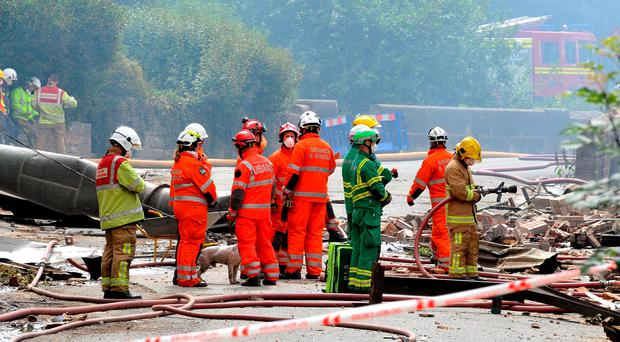 Search and rescue teams at the scene of the explosion at Wood Flour Mills in Cheshire