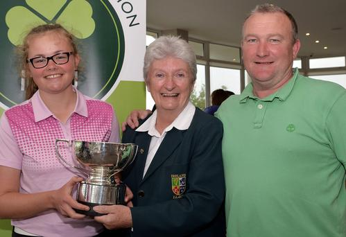 Repeat success : Lurgan's Annabel Wilson (left) with dad Andy and Irish Director of Junior Golf Irene Poynton after Annabel's tournament triumph in Galway
